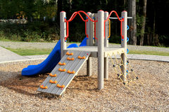 Slide at playground in a calm residential area. Slide at a playground in a calm residential area Royalty Free Stock Image