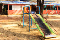 A slide on playground Stock Photos