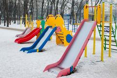 Slide at the playground in the winter Royalty Free Stock Photo