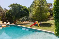 Slide and pool in a garden Royalty Free Stock Photo
