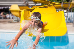 Slide in the pool Stock Images