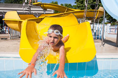 Slide in the pool Stock Image