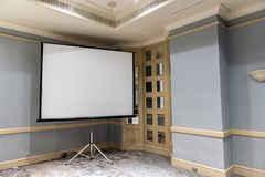 Slide projector white screen in the meeting room. Conference Stock Images