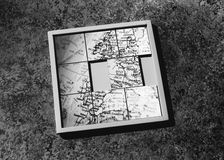 Slide-puzzle with jumbled map (b&w) Royalty Free Stock Photography
