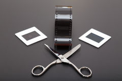 Slide , reversal film and scissors. Reversal Film, scissors and diapositives ( slides film). Old memories of the analogic photography royalty free stock image
