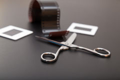 Slide , reversal film and scissors. Reversal Film, scissors and diapositives ( slides film). Old memories of the analogic photography royalty free stock photo