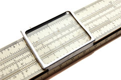 Slide rule. Isolated on a white background Stock Image