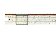 Slide rule. An obsolete slide rule isolated on white royalty free stock photography