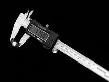 Slide rule. Precise micrometer on black bacground royalty free stock image