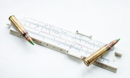 Slide rule and ammo Stock Photo