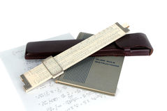 Slide rule and case. Slide rule with instruction book and case stock photo