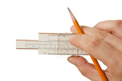 Slide rule in hand Stock Image