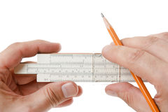 Slide rule in hand Royalty Free Stock Image