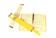 Slide Rules and Triginometery Book Isolated on White Royalty Free Stock Photo