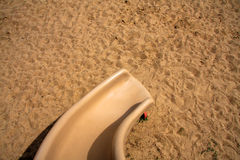 Slide on the sand. A slide on the sand for children playground Royalty Free Stock Images