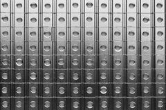 Slide screw nuts in a row, abstract industrial background Royalty Free Stock Photography