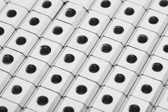 Slide screw nuts in a row, abstract industrial background Stock Images