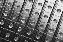 Slide screw nuts in a row, industrial background Stock Image