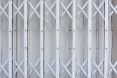 Slide steel locked shutter door, pattern. Background royalty free stock image