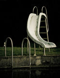 Slide into a swimming pool Royalty Free Stock Images
