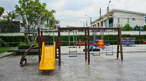 Slide and swings in a children's playground Royalty Free Stock Photos