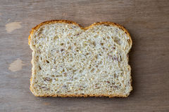Slide of Whole Grain Bread. A single slice of whole grain bread from above Royalty Free Stock Image