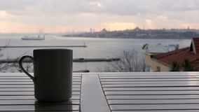 Slider, dolly coffee cup, background sultanahmet istanbul turkey stock video footage