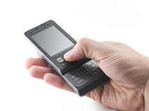 Slider mobile phone in a hand Royalty Free Stock Photography