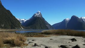 Slider shot of mitre peak and milford sound stock video footage