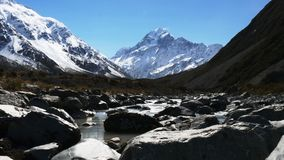 A slider shot of mt cook and river stock video footage