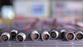 Slider shot video of blurry metal sockets for plugs