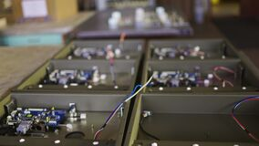 Slider shot of a metal components and microcircuits in workshop laboratory