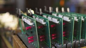 Slider shot of a PCB microcircuits in workshop laboratory