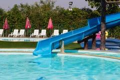 Slider beside swimming pool Stock Image