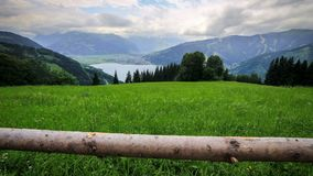 Slider time-lapse of austrian mountains, lake and stormy clouds stock video footage