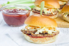 Sliders with beef brisket, barbecue sauce and coleslaw Stock Photos