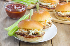 Sliders with beef brisket, barbecue sauce and coleslaw Royalty Free Stock Photos