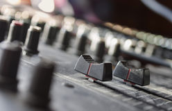 Sliders. Macro shot of mixing console sliders, indoor horizontal composition with shallow depth of field Royalty Free Stock Photos