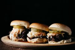 Pulled pork sliders on a wooden plate Stock Image