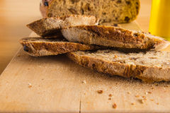 Slides of Handmade Bread on a Wood Table Stock Photo