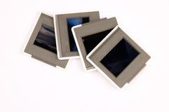 Slides isolated on white background stock photography