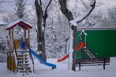 Slides for kids in the snowy park. Pesaro, Italy Stock Image