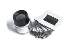 Slides and loupe. Slide and loupe on white background Royalty Free Stock Photography