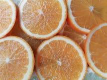 Slides Orange over lemon. Orenge and lemon cut into slides of bright an suggestive colors royalty free stock image