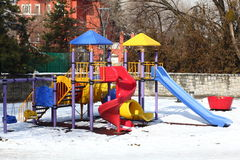 Slides in the park. Colorful slides in the park under the snow Royalty Free Stock Photo