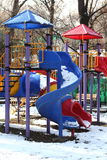 Slides in the park. Colorful slides in the park under the snow Stock Images