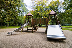 Slides in park during autumn, wide range of colors Royalty Free Stock Image