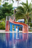 The slides by the pool toy for kids Royalty Free Stock Photo