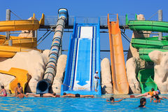 Slides in the water park. People in the pool Stock Images