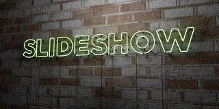 SLIDESHOW - Glowing Neon Sign on stonework wall - 3D rendered royalty free stock illustration Stock Image